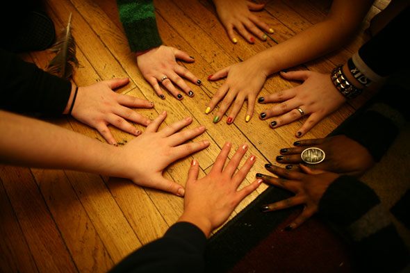 Teenage Girls' Hands on Table After Painting Fingernails