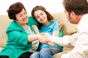 Young Teenage Girl and Mother Meeting with a Counselor or Psychologist in an Office