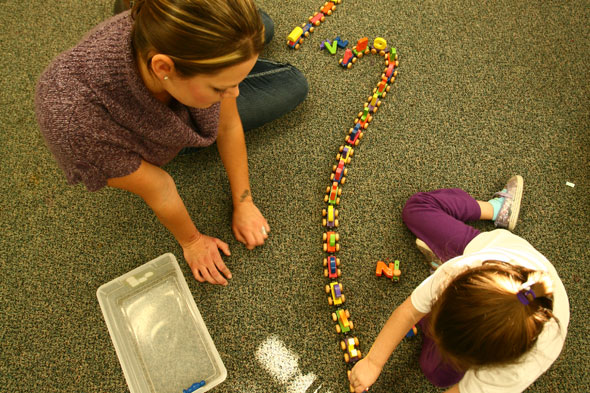 Family Solutions Staff Member Playing with Girl