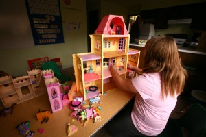 Girl Playing with Dollhouse at the Psychiatric Day Treatment Program