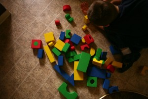 Boy Playing with Wooden Colored Blocks