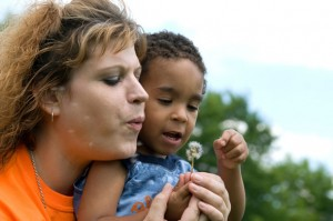 Foster Mother with Young Boy Holding a Dandelion
